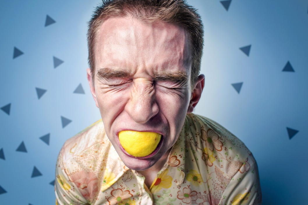 Man Sucking Lemon